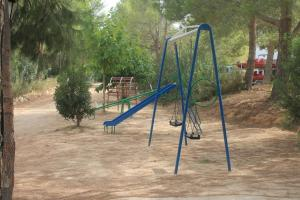 Children's play area at Casas Rurales El Cañar
