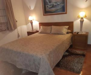 A bed or beds in a room at Casa Das Aguas Ferreas