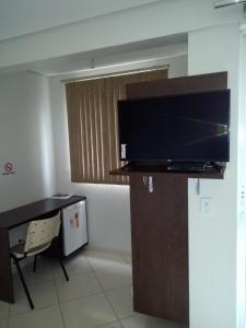A television and/or entertainment center at Mb Hotel