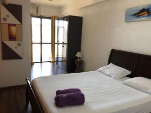 A bed or beds in a room at Penthouse duplex with Private Pool and View in Copacabana