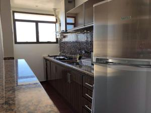 A kitchen or kitchenette at Penthouse duplex with Private Pool and View in Copacabana