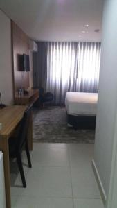 A seating area at Itaipava, Flat 213