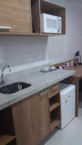 A kitchen or kitchenette at Itaipava, Flat 213