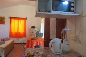 A television and/or entertainment center at Cabañas Peretei