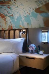 A bed or beds in a room at Hard Rock Hotel Daytona Beach