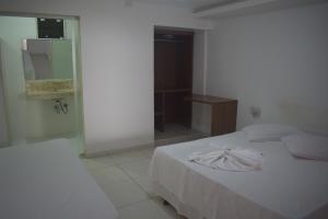 Cama ou camas em um quarto em Pousada Vida Boa