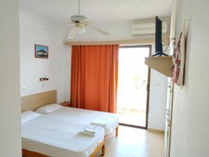 Ένα ή περισσότερα κρεβάτια σε δωμάτιο στο Kyriakos Studios