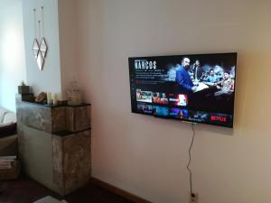 A television and/or entertainment centre at Irina&Gianpaolo