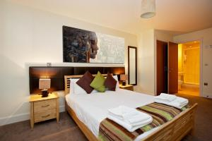 A bed or beds in a room at Staycity Aparthotels Birmingham City Centre Arcadian