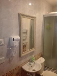A bathroom at Apartment on Ostrovskogo 58