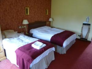 A bed or beds in a room at Corbett Court