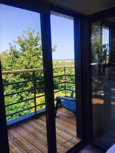 Balcon ou terrasse dans l'établissement Cottage vue mer