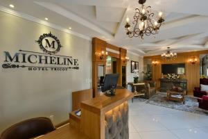 The lobby or reception area at Micheline Hotel Tricot