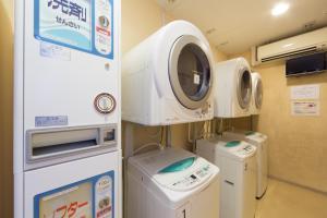 A kitchen or kitchenette at HOTEL MYSTAYS Fukuoka Tenjin Minami