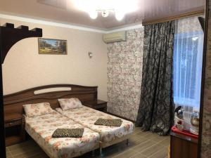 Кровать или кровати в номере Гостевой дом Афина