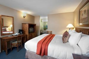 A bed or beds in a room at Maligne Lodge