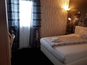 Ein Bett oder Betten in einem Zimmer der Unterkunft Hotel Ackermann