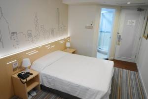 A bed or beds in a room at West Hotel