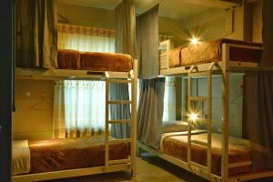 A bunk bed or bunk beds in a room at Downtown @ Mandalay