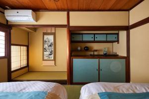 京町家ホテル三福にあるベッド