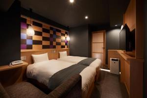 サクラ スカイ ホテルにあるベッド