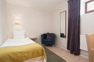 Säng eller sängar i ett rum på Clarion Collection Hotel Kung Oscar