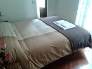 Cama o camas de una habitación en Hostal Esmeralda