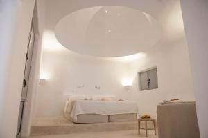 Ένα ή περισσότερα κρεβάτια σε δωμάτιο στο Lindos Sun Hotel
