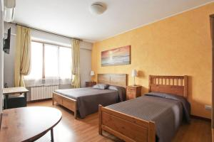 A bed or beds in a room at Vacanze a Roma