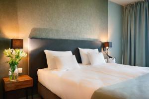 Łóżko lub łóżka w pokoju w obiekcie Focus Hotel Poznań