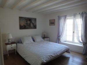 Un ou plusieurs lits dans un hébergement de l'établissement Couleurs et jardin