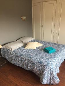 Un ou plusieurs lits dans un hébergement de l'établissement Chambre