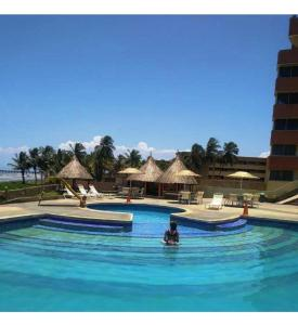The swimming pool at or near Apartamento Guaruja