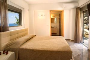 A bed or beds in a room at Blue Dream Luxury Villas