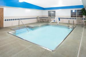 The swimming pool at or close to Microtel Inn & Suites by Wyndham Springfield