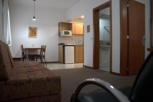 A kitchen or kitchenette at Apto no Union Residence