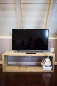 Uma TV ou centro de entretenimento em Apartment in Pietermaai