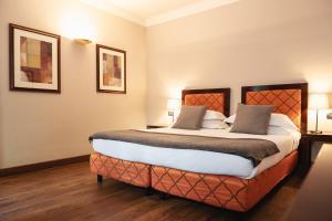 Кровать или кровати в номере San Gallo Palace