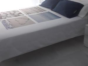 Cama o camas de una habitación en Apartamento Las 4 Palmeras