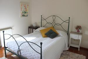 A bed or beds in a room at Quinta do Sardão