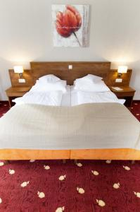 Ein Bett oder Betten in einem Zimmer der Unterkunft Pension Düver