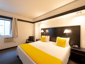 A bed or beds in a room at Hotel Normandie