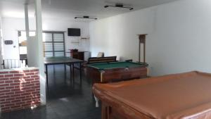 A pool table at Chácara do Seu Dito