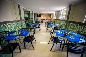 A restaurant or other place to eat at Cllin Premium Plaza