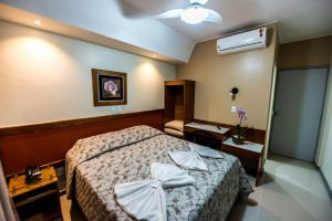A bed or beds in a room at Cllin Premium Plaza