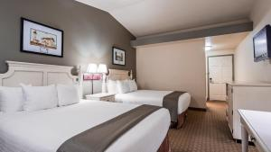 A bed or beds in a room at Best Western Inn at Face Rock
