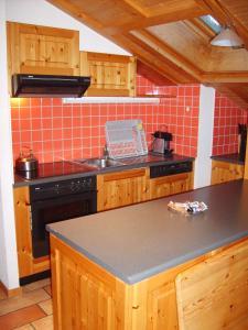 Cuisine ou kitchenette dans l'établissement Résidence Castel Club Leysin Parc