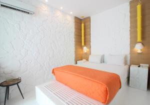 A bed or beds in a room at Bellissimo Resort