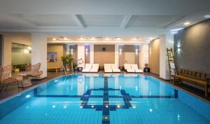 The swimming pool at or near Van der Valk Hotel Hildesheim