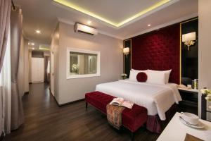 A bed or beds in a room at Hanoi L'Heritage Centre Hotel & Spa